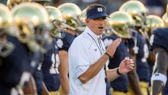 Sep 5, 2015: Notre Dame Fighting Irish offensive coordinator Mike Sanford, Jr. watches warmups before the game against the Texas Longhorns at Notre Dame Stadium. Notre Dame won 38-3.