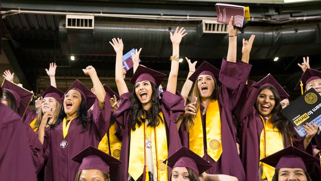 ASU students cheer during graduation ceremonies at Chase Field in Phoenix May 9, 2016.