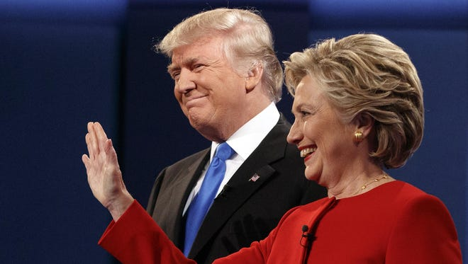 Republican presidential candidate Donald Trump stands with Democratic presidential candidate Hillary Clinton at the first presidential debate at Hofstra University, Monday.