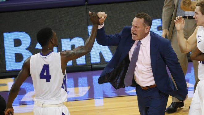 Grand Canyon University forward Oscar Frayer (4) slaps hands with head coach Dan Majerle during the second half against San Diego State at GCU Arena in Phoenix, Ariz. December 7, 2016.