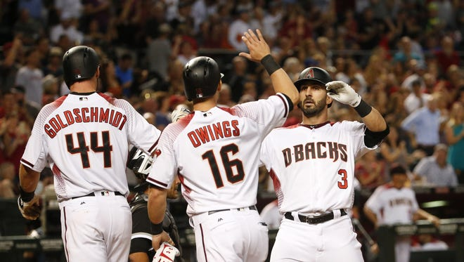 Arizona Diamondbacks' Daniel Descalso (3) is congratulated by Paul Goldschmidt (44) and Chris Owings (16) after hitting a three-run home run against the Chicago White Sox during the fourth inning at Chase Field in Phoenix, Ariz. May 22, 2017.