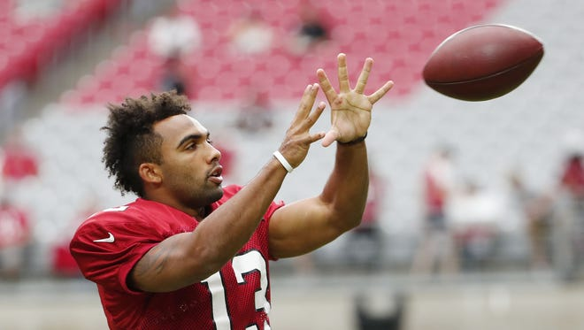 Arizona Cardinals wide receiver Christian Kirk (13) catches a ball during camp at University of Phoenix Stadium in Glendale, Ariz. August 8, 2018.