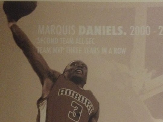Marquis Daniels is featured on a graphic in the Auburn men's basketball office.