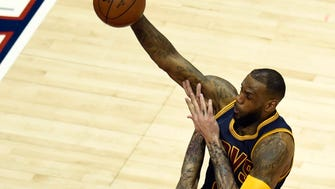 Cleveland Cavaliers forward LeBron James (23) drives to the basket against Atlanta Hawks forward Pero Antic (6) during the first half in game two of the Eastern Conference Finals of the NBA Playoffs at Philips Arena.