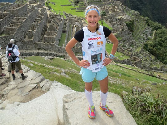 Winter Vinecki stands at the top of the Inca Trail at Machu Picchu after completing her fourth marathon within the marathon tour. Winter took first place overall in the Inca Trail to Machu Picchu Marathon, and says it was her favorite race so far.