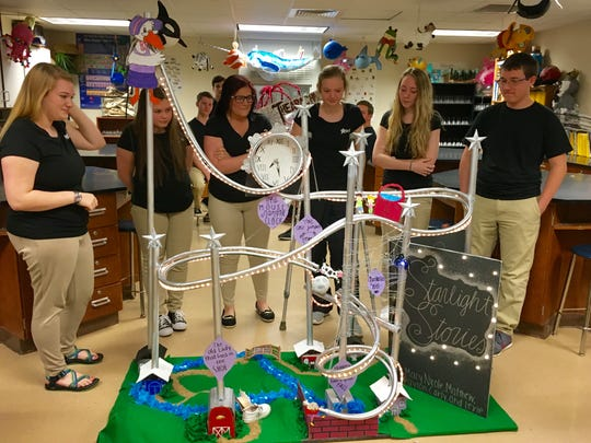 "Buckeye High School seniors in Advanced Placement physics test their marble roller coasters Monday, including the storybook-themed ""Starlight Stories."""