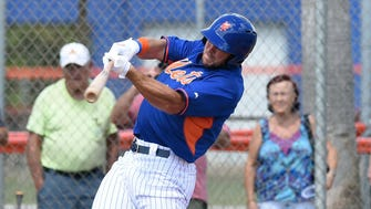 Tim Tebow hits a home run in his first at-bat.