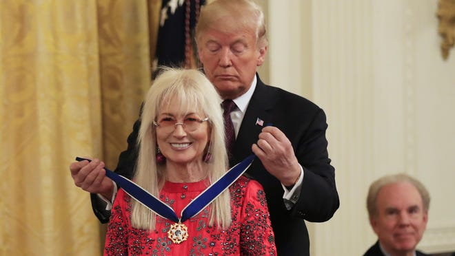 President Donald Trump presents the Presidential Medal of Freedom to major Republican Party donor Miriam Adelson during a ceremony in the East Room of the White House, in Washington, Friday, Nov. 16, 2018.