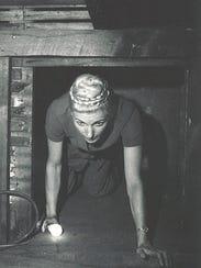 Owner Marlene Hansen emerges from a secret room discovered