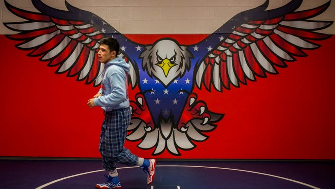 Veterans Memorial's Daniel Leal runs laps around the mat  during their wrestling practice on Wednesday, Feb. 21, 2018 at Veterans Memorial High School.