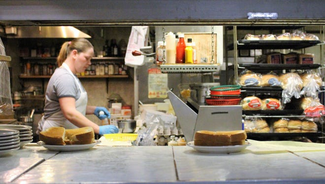 Amber Lines prepares a meal for the morning crowd at the Shovel restaurant on Friday.