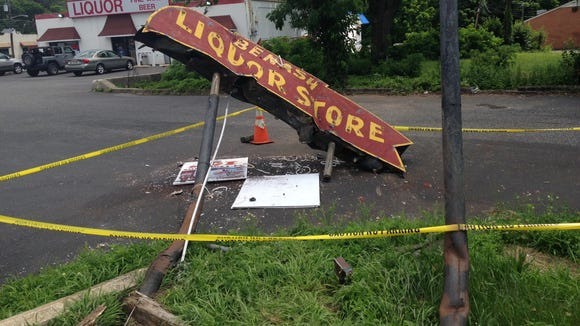 An alleged drunk driver early Friday morning took out the landmark Benash Liquor Store sign at Route 38 and Church Road.