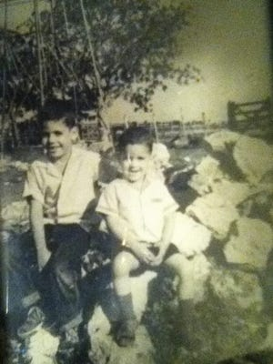 Jorge Fitz-Gibbon, at right, in the mid-1960s at his family's cattle ranch in San Jose, Cuba.