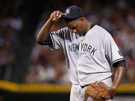 New York Yankees' Michael Pineda pauses on the mound after giving up a run against the Arizona Diamondbacks during the second inning of a baseball game Tuesday, May 17, 2016, in Phoenix. (AP Photo/Ross D. Franklin)