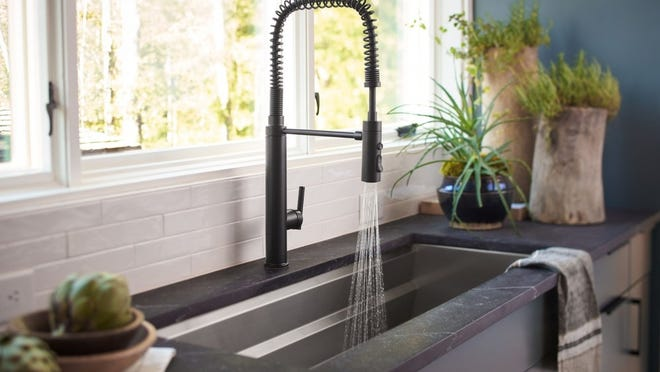 A well-designed kitchen sink and arched faucet are perfect complements for the ardent chef.