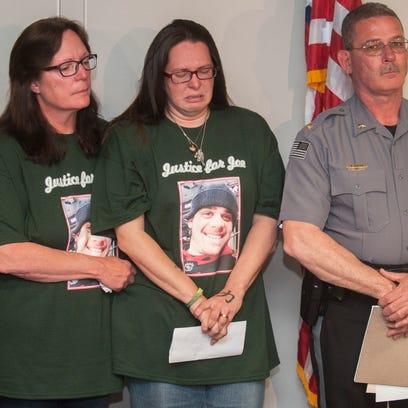 Megan Pirri, center, wife of Joseph Pirri, sheds tears