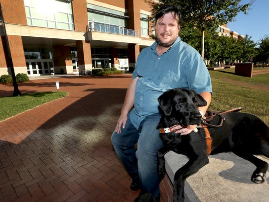MTSU student Thomas Jones and his service dog Blake