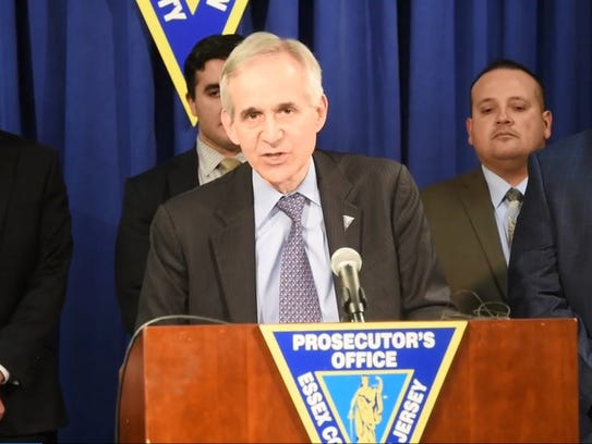 Acting Essex County Prosecutor Robert D. Laurino holds