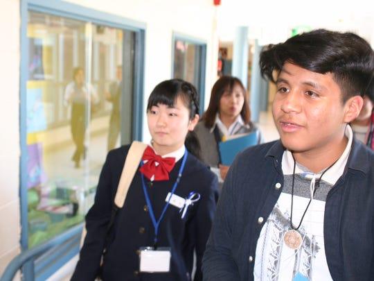 New Brunswick Middle School sixth-grader Bryan Rodriguez (right) shows off his school to Hinako Suzuki of New Brunswick Sister City Fukui, Japan.