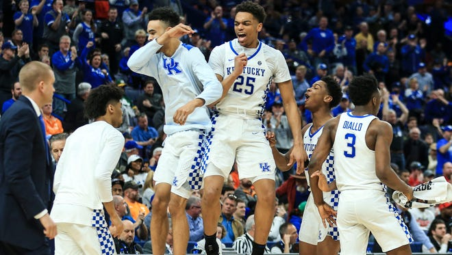 Kentucky's PJ Washington celebrates with teammates in the second half as the Wildcats took a commanding lead over Georgia  Friday afternoon in the 2018 SEC Tournament at the Scotttrade Center in St. Louis. The Wildcats eliminated the Bulldogs from the tourney for the fourth time in five years.