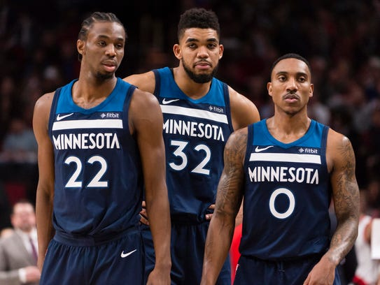 Andrew Wiggins (22), Karl-Anthony Towns (32) and Jeff