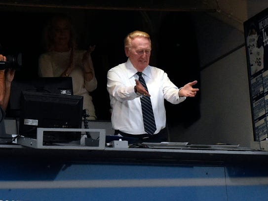 Minutes before every broadcast at Dodger Stadium, Vin