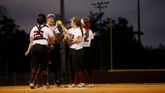Chiles' players gather at the mound against during their game against Lincoln at Chiles High School last week.