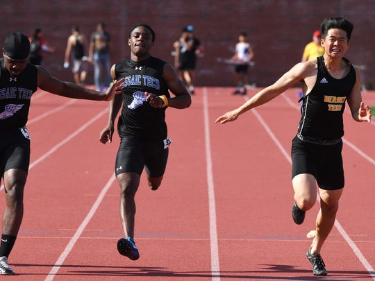 Big North Liberty Championships on Wednesday, May 2, 2018. (right) Jayjoon Sin, of Bergen Tech, on his way to finishing first in the 100M. (from left) Shaheem Maple and Neimar Santouse, of Passaic Tech.