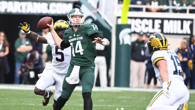 Oct 29, 2016; East Lansing, MI, USA; Michigan State quarterback Brian Lewerke attempts a pass as Michigan linebacker Jabrill Peppers (5) defends during the second half at Spartan Stadium.