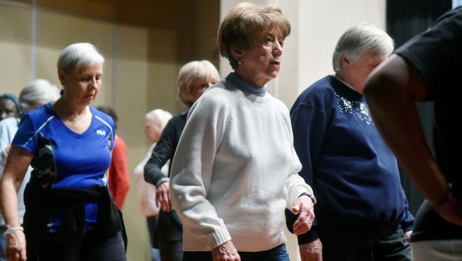 Joan Nolin, 72 of Jackson Township, practices a basic step with other seniors at a beginner tap dance class Friday, Jan. 20, 2017, at Windy Hill on the Campus Senior Center in Jackson Township. More than a dozen people attended the first class; if interest is sustained, more classes will be held on subsequent Fridays.
