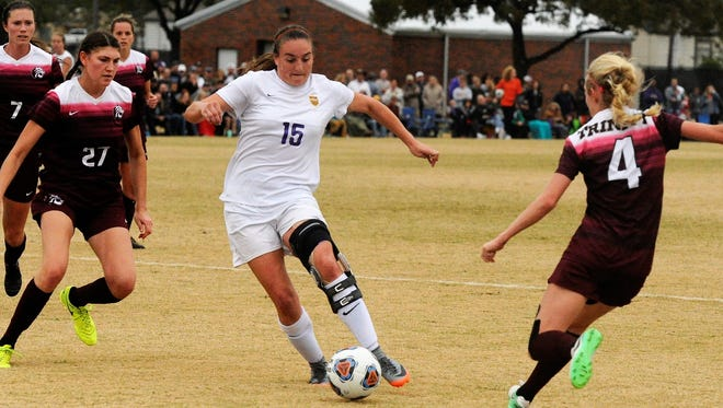 Hardin-Simmons senior forward Kami Jones tries to split a pair of defenders during Sunday's NCAA Division III second round game against Trinity. The No. 3 Cowgirls scored twice in the final 10 minutes to win 3-2.