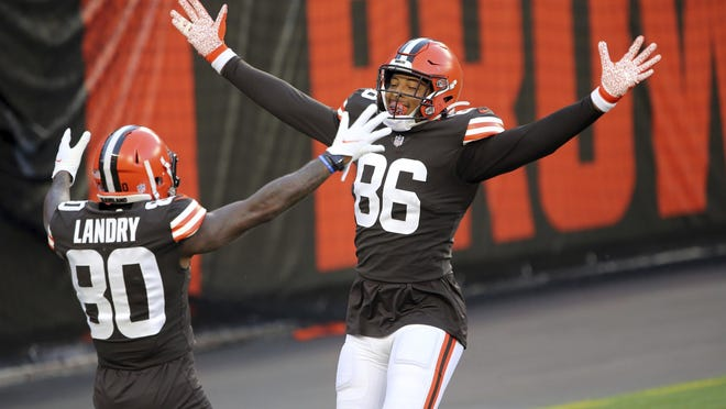 With no defense on the field for the drive, Cleveland Browns tight end Pharaoh Brown jokingly celebrates his touchdown catch with Jarvis Landry during the NFL football team's scrimmage Friday, Sept. 4, 2020, in Cleveland.