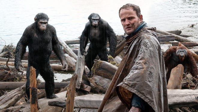 "This photo released by Twentieth Century Fox Film Corporation shows Jason Clarke, as Malcolm, foreground, and, background from left, Andy Serkis, as Caesar; Toby Kebbell, as Koba; and Karin Konoval, as Maurice; in a scene from the film, ""Dawn of the Planet of the Apes."""