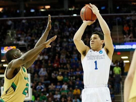 Kentucky Wildcats guard Devin Booker shoots over Notre
