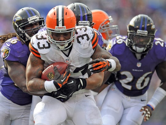 Cleveland Browns running back Trent Richardson carries the ball   against the Baltimore Ravens in 2013.