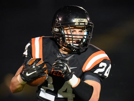St. Cloud Tech's Austin Brenner finds room to run against