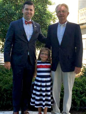 Rick Lemcke, right, pictured with his granddaughter, Anna, and his son, Brett.
