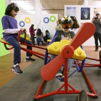 Young visitors played on a gyroscopic airplane during the El Paso Exploreum's opening in 2013.