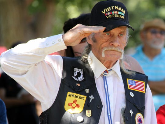 Vietnam Veteran George F. Tobin, Jr. salutes during the playing of a service song. Tobin served from 1970-72.