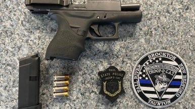 State police say they seized a loaded Glock 42 .380-caliber firearm from a Mattapan man during a motor vehicle stop in Brockton, Saturday, July 25, 2020.
