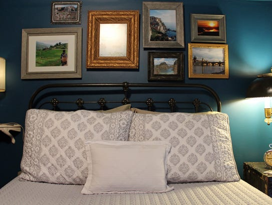 Room décor is a mix of travel photos, local art and