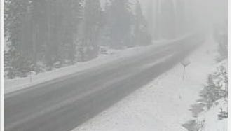 Snow falling on Santiam Pass Friday morning.