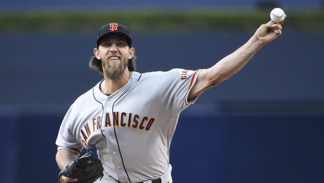 Madison Bumgarner of the San Francisco Giants pitches during the first inning against the San Diego Padres at PETCO Park on Saturday.