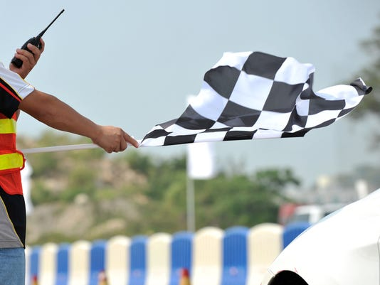 Checkered racing flag being shown to start the race