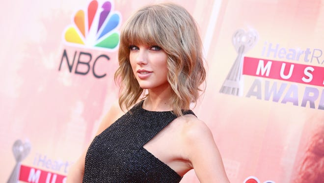 Taylor Swift arrives at the iHeartRadio Music Awards at The Shrine Auditorium on Sunday, March 29, 2015, in Los Angeles.