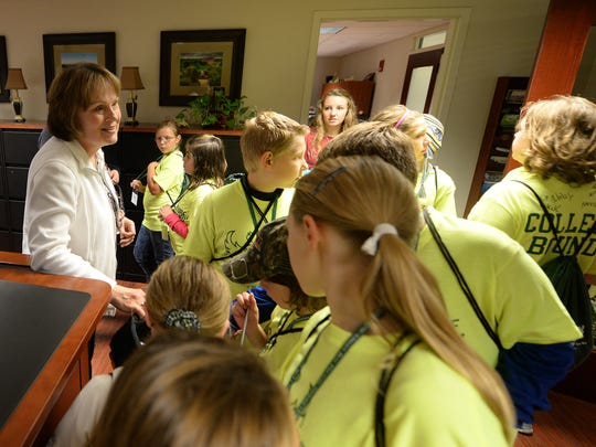 Becky Ouradnik, left, of the UW-Green Bay chancellor's office, explains what the chancellor does to a group of Oconto Middle School students during the Phuture Phoenix program at UW-Green Bay.