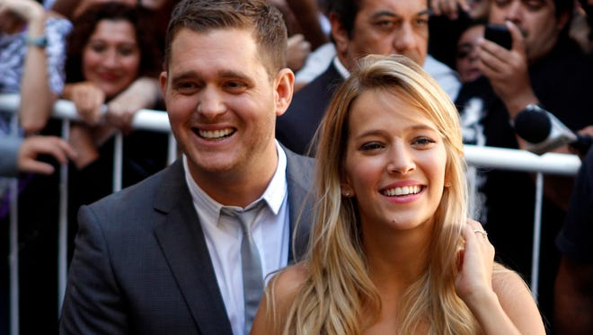 Michael Bublé and his wife, Argentine actress Luisana Lopilato, in Buenos Aires, in March 2011.