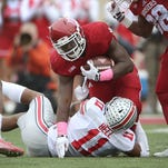 Indiana Hoosiers running back Jordan Howard (8) is stopped by Ohio State Buckeyes safety Vonn Bell (11) in the first half of their game. Oct 3, 2015; Bloomington, IN, USA; [CAPTION] at Memorial Stadium. Mandatory Credit: Matt Kryger-USA TODAY Sports