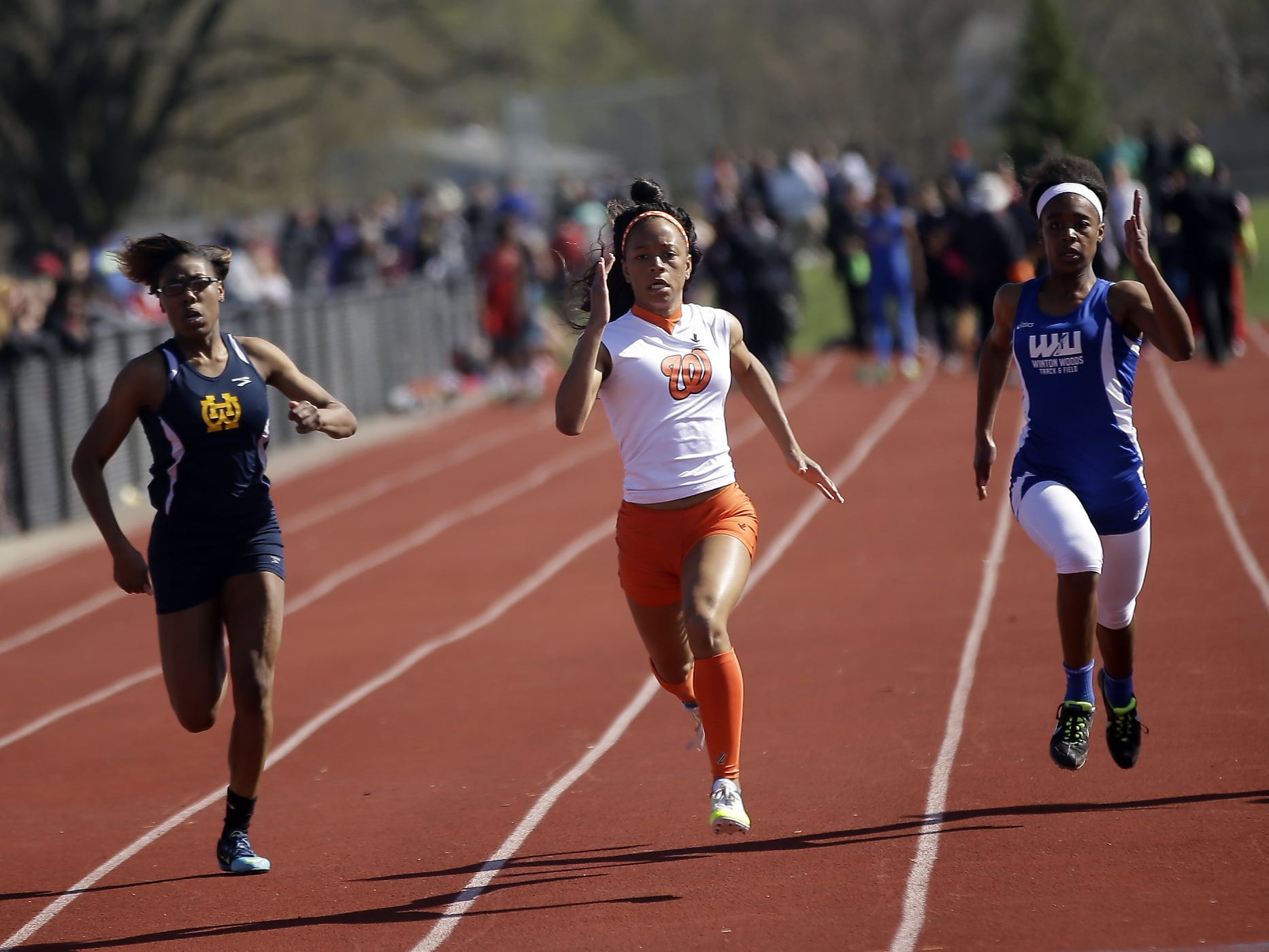 Withrow's Destiny Pennington, (center) wins the girls 100 meters beating out Walnut Hills Arissa Freeman of Walnut Hills and Brianna Richard of Winton Woods at the Coaches Classic April 10.