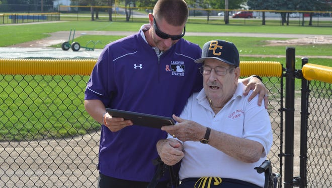 2017 Wall of Fame inductee Kyle Kracht (left) is presented with a plaque from Bob Owen of the Battle Creek Area Amateur Sports Association.